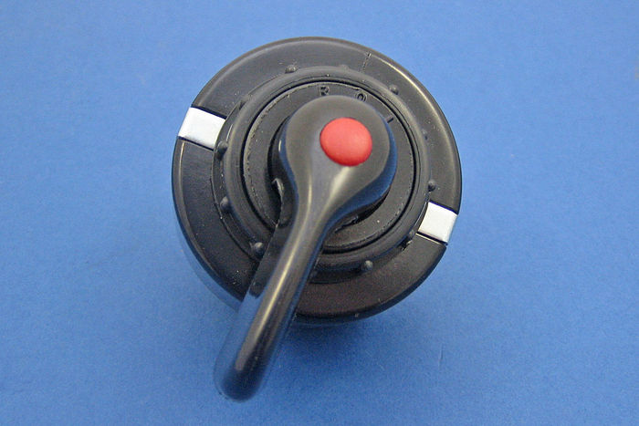 Rotary switch - black plastic lever and integral red warning lamp