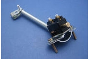 Mechanical switch with spring and clamp