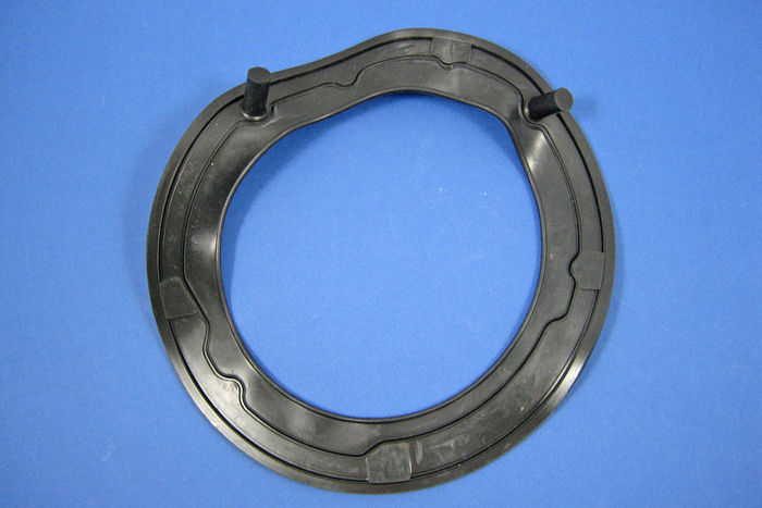 Headlamp shell mounting gaskets
